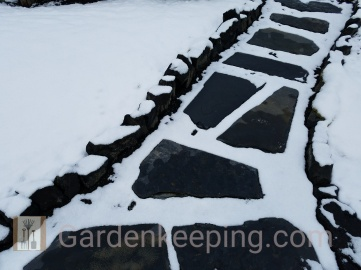 Even in the snow, the flagstone show the way.