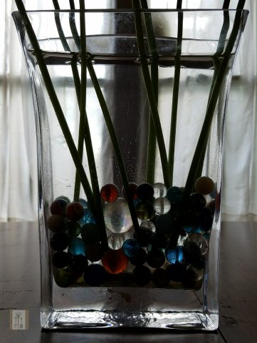 The stems are held in place by marbles that have been found in the garden over the years!